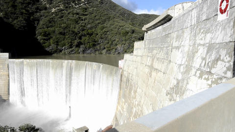 Dolly shot of Matilija Creek spilling over the obs Stock Video Footage
