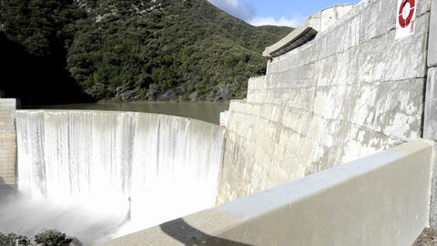 Dolly shot of Matilija Creek spilling over the obs Footage