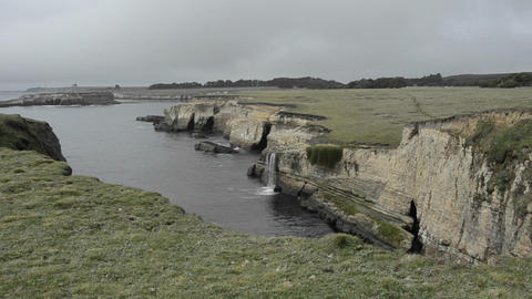 Coastal waterfall and bluffs at Point Arena, Calif Stock Video Footage