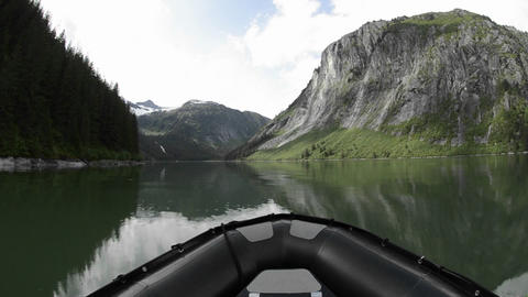 POV boat ride cruising through a glassy waters in Stock Video Footage
