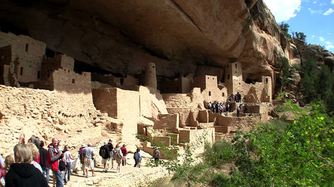 Handheld shot of tourists walking up to Mesa Verde Stock Video Footage