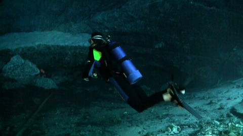 A scuba diver explores underwater caves in Florida Footage