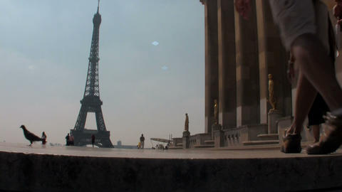 Tourists walk towards the Eiffel Tower in paris Stock Video Footage