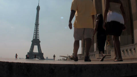 Tourists walk towards the Eiffel Tower in paris Footage