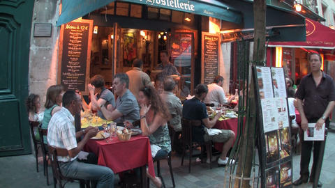 Handheld shot of diners in a Paris cafe, France Stock Video Footage