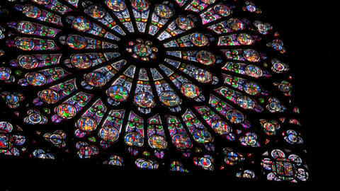 A round stained glass window in a darkened cathedr Stock Video Footage