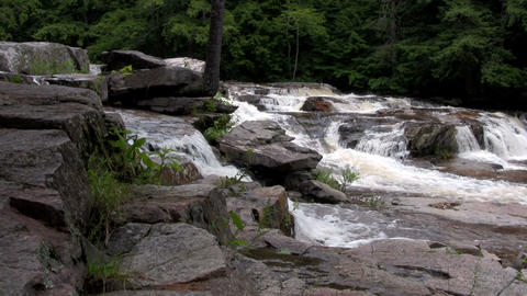 A waterfall flows through the forest in New Hampsh Stock Video Footage