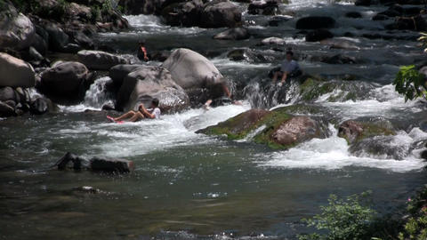 People float down a river on innertubes Stock Video Footage