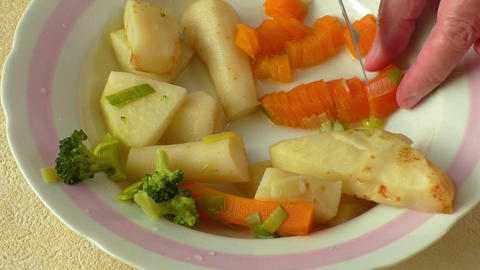 Chopped vegetable prepared for soup cooking Footage