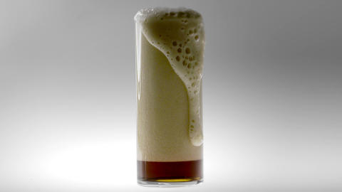 180fps Super Slow Motion Brown Beer Froth into Glass Live Action