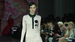 Model shows clothes at the fashion show on the catwalk Footage