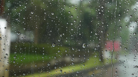 Rain drops on windows Focus on rain drops down the window in rainy day Footage