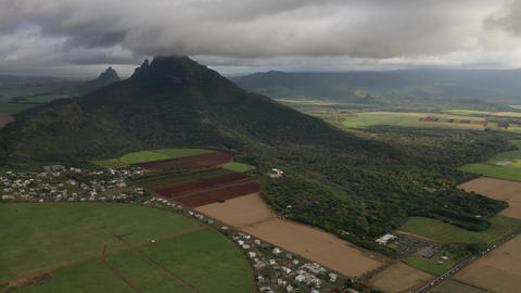 Aerial photography of the beautiful green countryside of Mauritius with fields Live Action