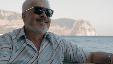 Senior Man In Sunglasses Sitting On On Luxury Yacht Looking To The Sea Footage
