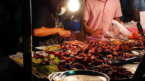 Thai Street Food sellers on night street Grilled Chicken Or BBQ With Charcoal ,T Footage
