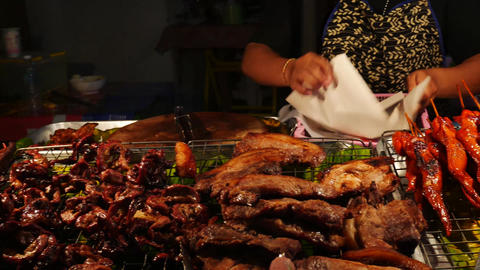 Thai Street Food sellers on night street Grilled Chicken Or BBQ With Charcoal ,T Live Action