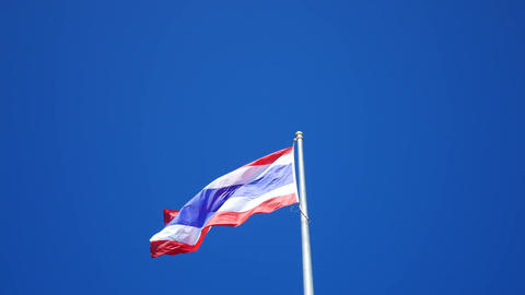 Flag of Thailand waving with blue sky background Footage