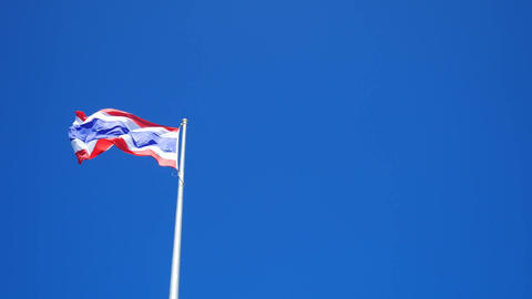 Flag of Thailand waving with blue sky background Filmmaterial