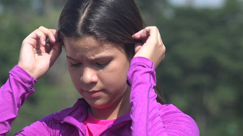 Female Teen Fixing Her Hair Footage