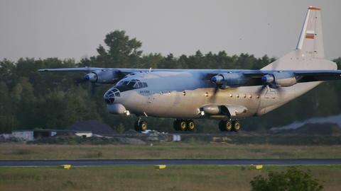 Transport aircraft Antonov AN-12 landing Live Action