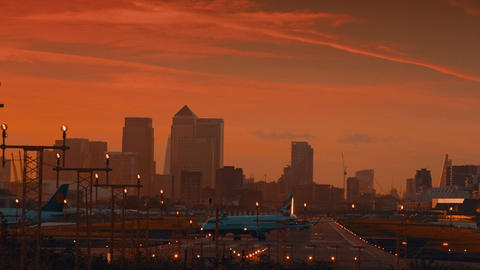 London City Airport - Three large planes preparing to take off by sunset Footage