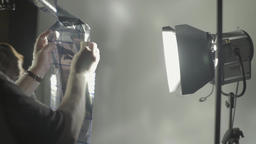 The illuminator works with light in photo Studio Footage