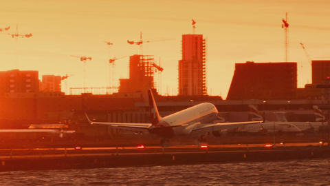 London City Airport - Ultra closeup shot of a large airline landing against a su Footage
