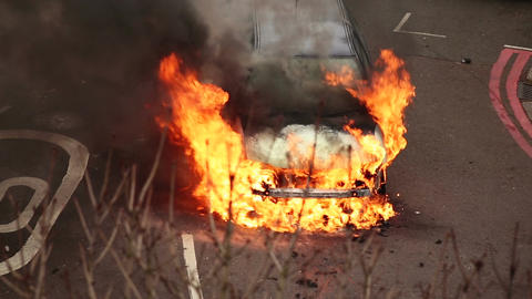 Car being engulfed by flames after accident Footage