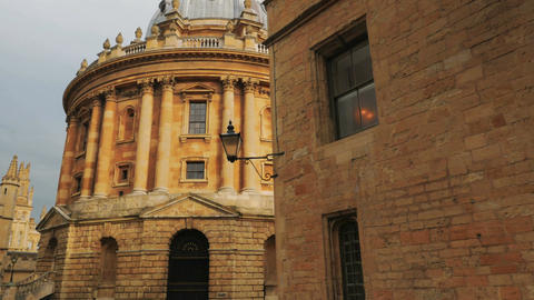 Cinematic POV shot revealing iconic college buildings in the town of Oxford, UK Footage