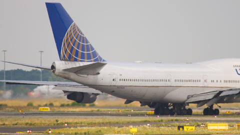 United Airlines Boeing 747 airliner taxiing to runway for departure Live Action