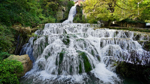 Orbaneja del Castillo waterfall, famous touristic destination in Burgos province Live Action