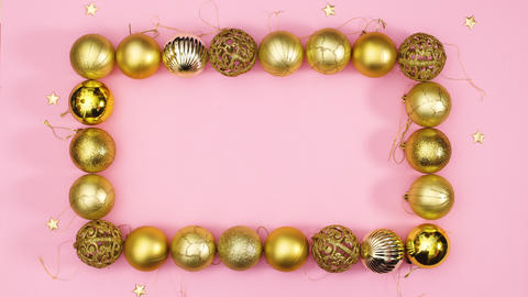 Gold Christmas frame with gold stars around and empty space for text in frame. Stop motion Live Action