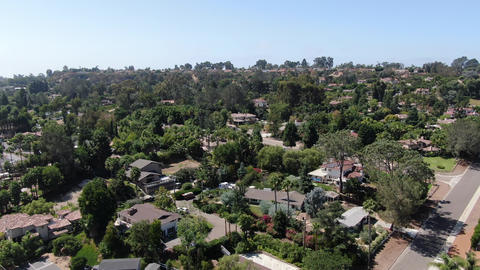 Aerial view of Encinitas town with large villa and blue sky Live Action