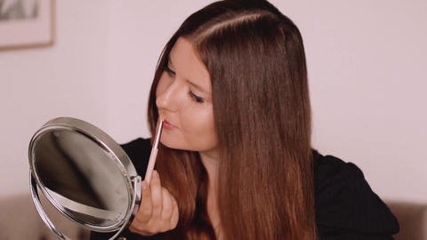 Beauty blogger applying makeup in front of mirror, portrait of beautiful model Live Action