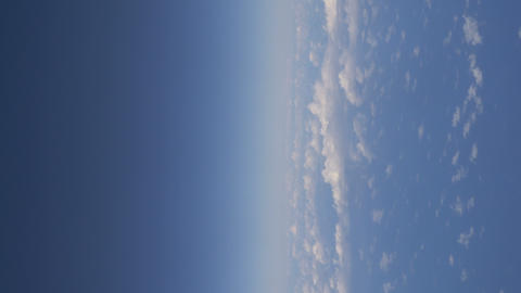 Vertical video of flight above the clouds in 4k Live Action
