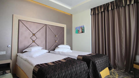 Hotel room with two beds and modern decor 70a Footage
