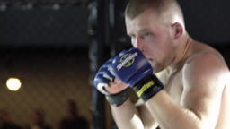 The fighter fights in the cage . MMA. Slow motion Footage
