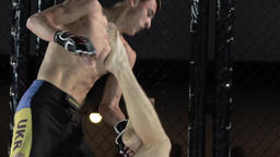 Fight in the cage .MMA. Slow motion Footage