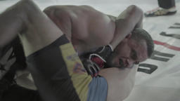 The fight in the octagon . MMA Footage