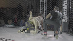 Spectacular fight in the cage . MMA Footage