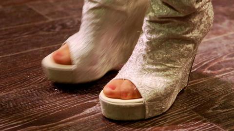 Closeup Girl in Modern Silver High Heel Boots Dance on Floor Footage