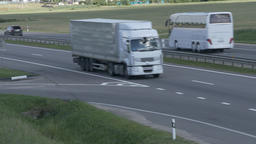 4K Ungraded: White Truck Drives on Intercity Highways Live Action