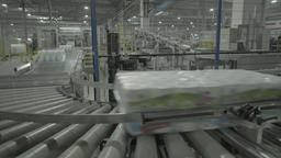 Move products on the conveyor at a paper mill Live Action