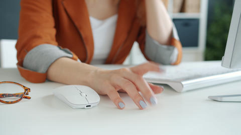 Close-up of female hands moving on desktop in office while businesswoman feeling Live Action