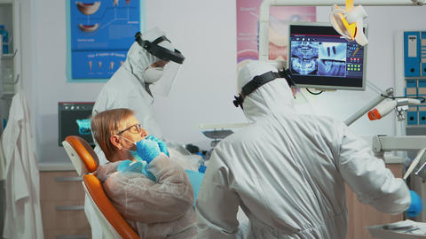 Woman taking care of tooth health during covid-19 pandemic Live Action