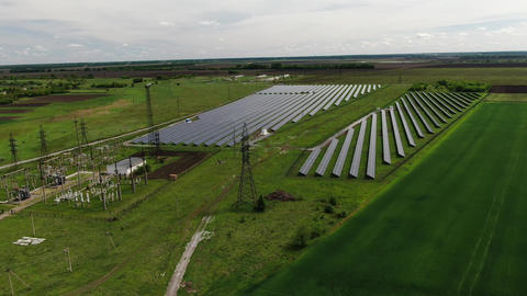 Drone view on a massive solar power station, amazing renewable energy, 4k Live Action