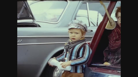 United Kingdom 1969, Mom give drink at child in a parking, Family lifestyle moment Live Action