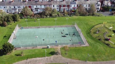 Aerial Overhead Drone Shot Descending Over Park Tilt Up see City Houses (2.7k) Live Action