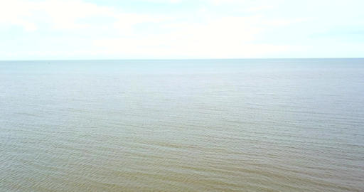 Aerial Overhead Drone Shot Flying Over Ocean Sea towards Horizon (4K UHD) Live Action