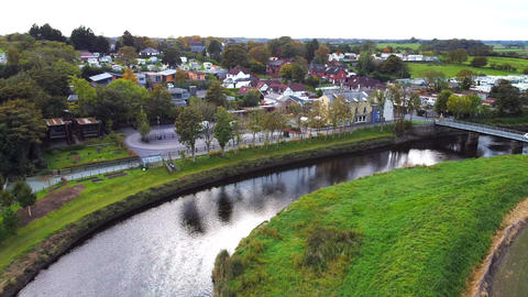 Aerial Overhead Drone Shot Flying over River and Bridge by Village (4K) Live Action
